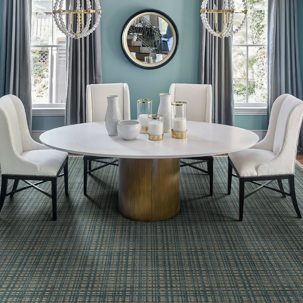 Blue and green area rug in dining room.