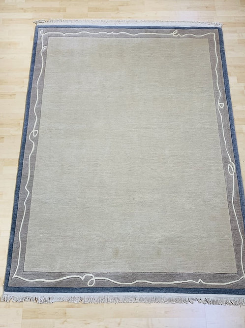 Beige Rug with Scroll Border