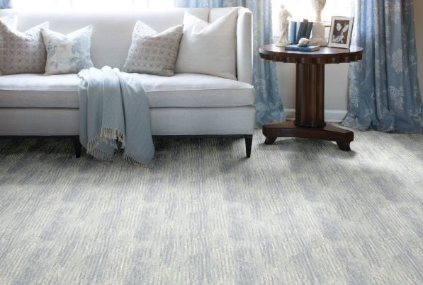 Light blue and grey wall-to-wall carpet in living room.