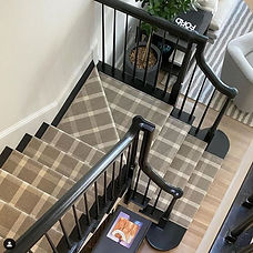 Grey plaid carpet on stairs