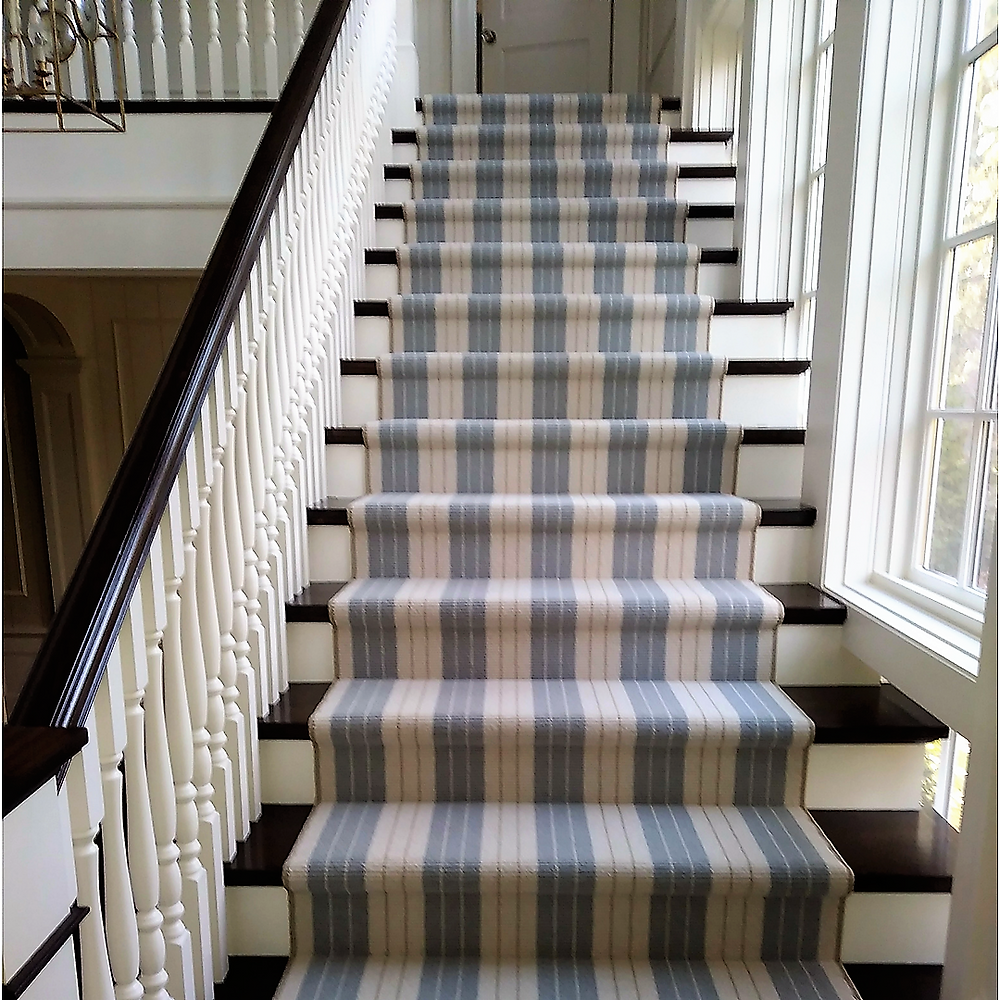 Blue and cream striped carpet on staircase.