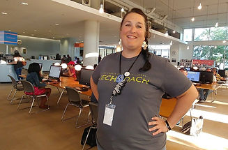 Tech Coach, Sara, stands proudly in service at Plaza Library.