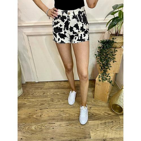 Cow print denim shorts