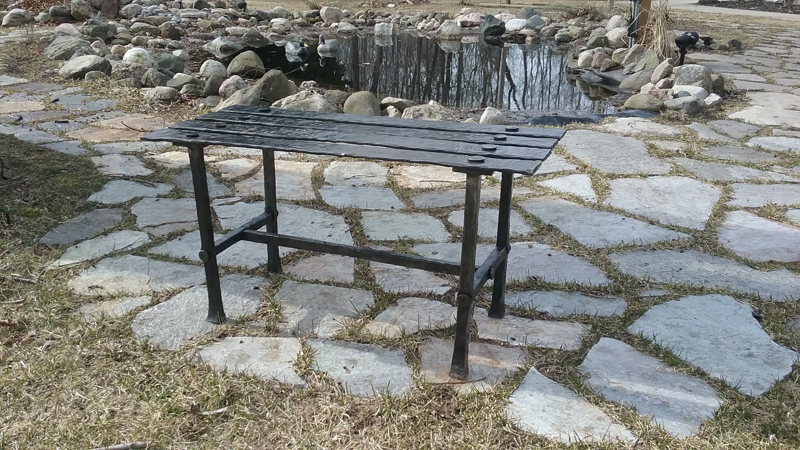 Hand forged iron bench