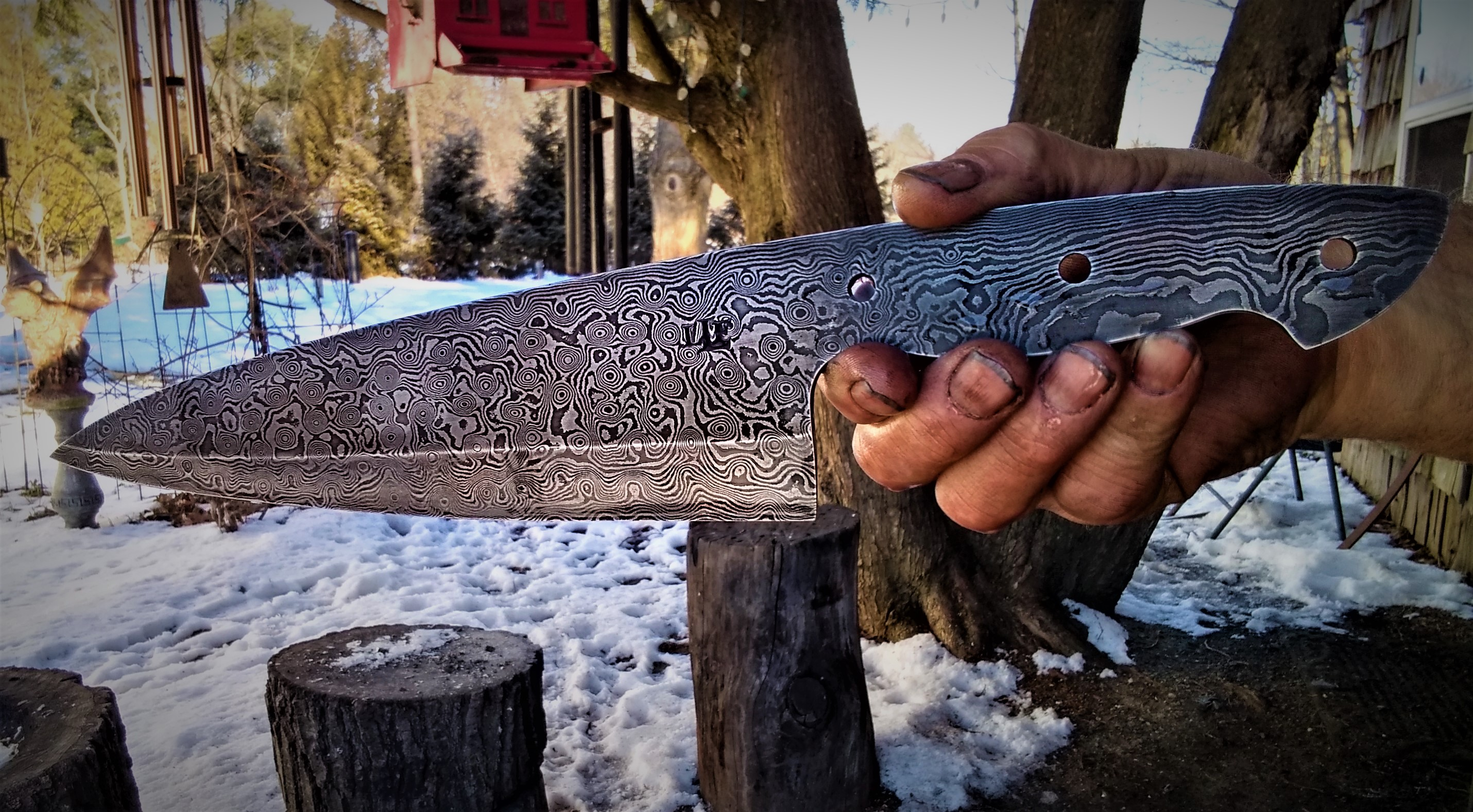 Custom raindrop damascus chef's knife