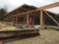 Modified Global Model Earthship build in Kemptville Ontario Canada. Main bearing wall and roof beams.