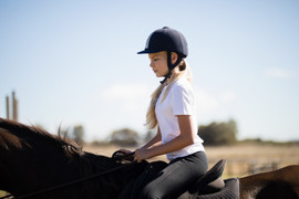 girl-riding-a-horse-in-the-ranch-L862M4T