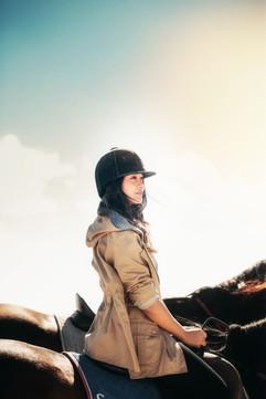 young-woman-riding-a-horse-JKXJVDJ.jpg