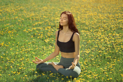young-girl-doing-yoga-in-the-park-DUMGWB