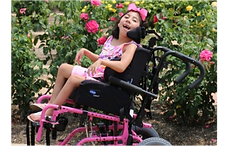 Little girl in wheelchair.png