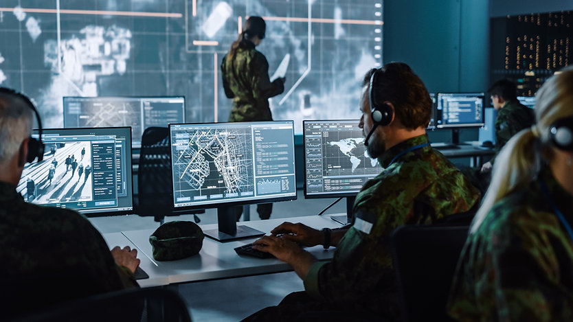 Military Surveillance Officer Working on a City Tracking Operation in a Central Office Hub
