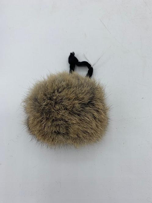 Fur ball hair toggle