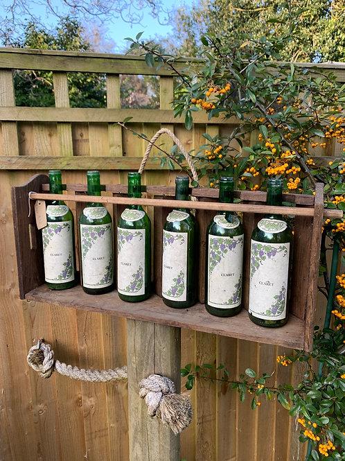 Vintage wine bottle rack with bottles