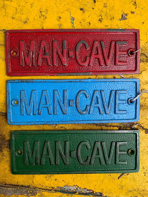 Green MAN CAVE sign