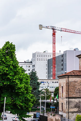 red-crane-tower-beside-white-building-24
