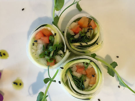 Raw food cucumber open rolls with tomato salsa and garnished with sunflower greens. health detox retreat UK