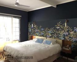 Wallpaper strip above bed