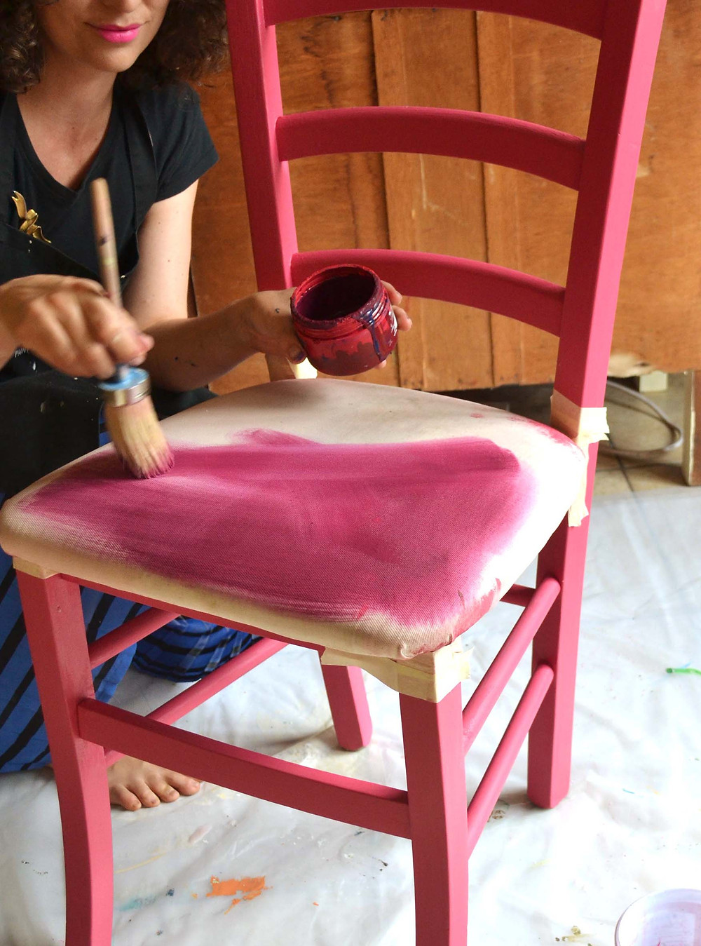 Paint the first coat over the wet upholstery