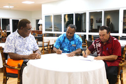 Fisheries Minister Dr Lino Tom, NFA Managing Director John Kasu meet with Acting PA for Madang to sign MOA