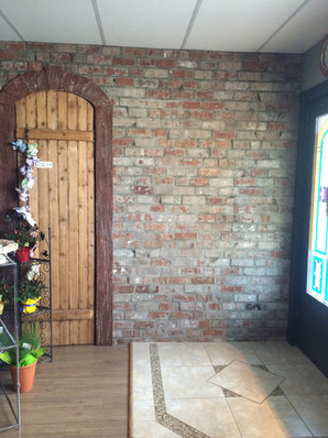 Creating interior brick wall with curved door