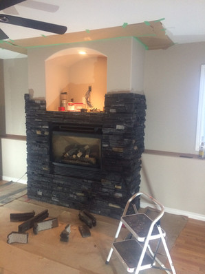DURING: Stone fireplace