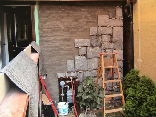 DURING: Exterior stone wall
