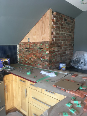 DURING: Extending brick feature wall
