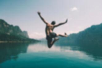 guy jumping in lake.jpg