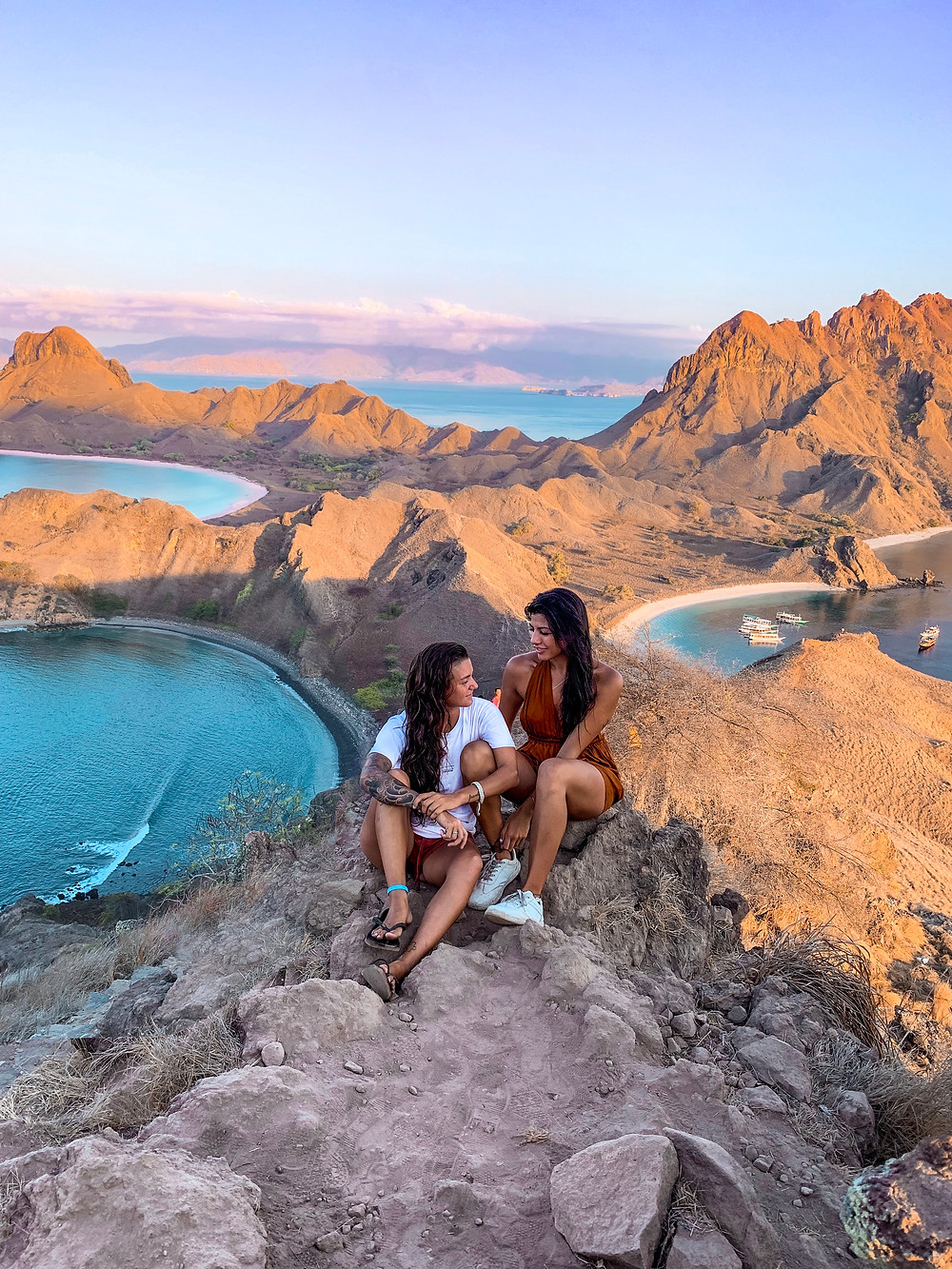 Padar Island. A beautiful island resting between Komodo and Rinca islands. At the top of the hike you can see three colored beaches.