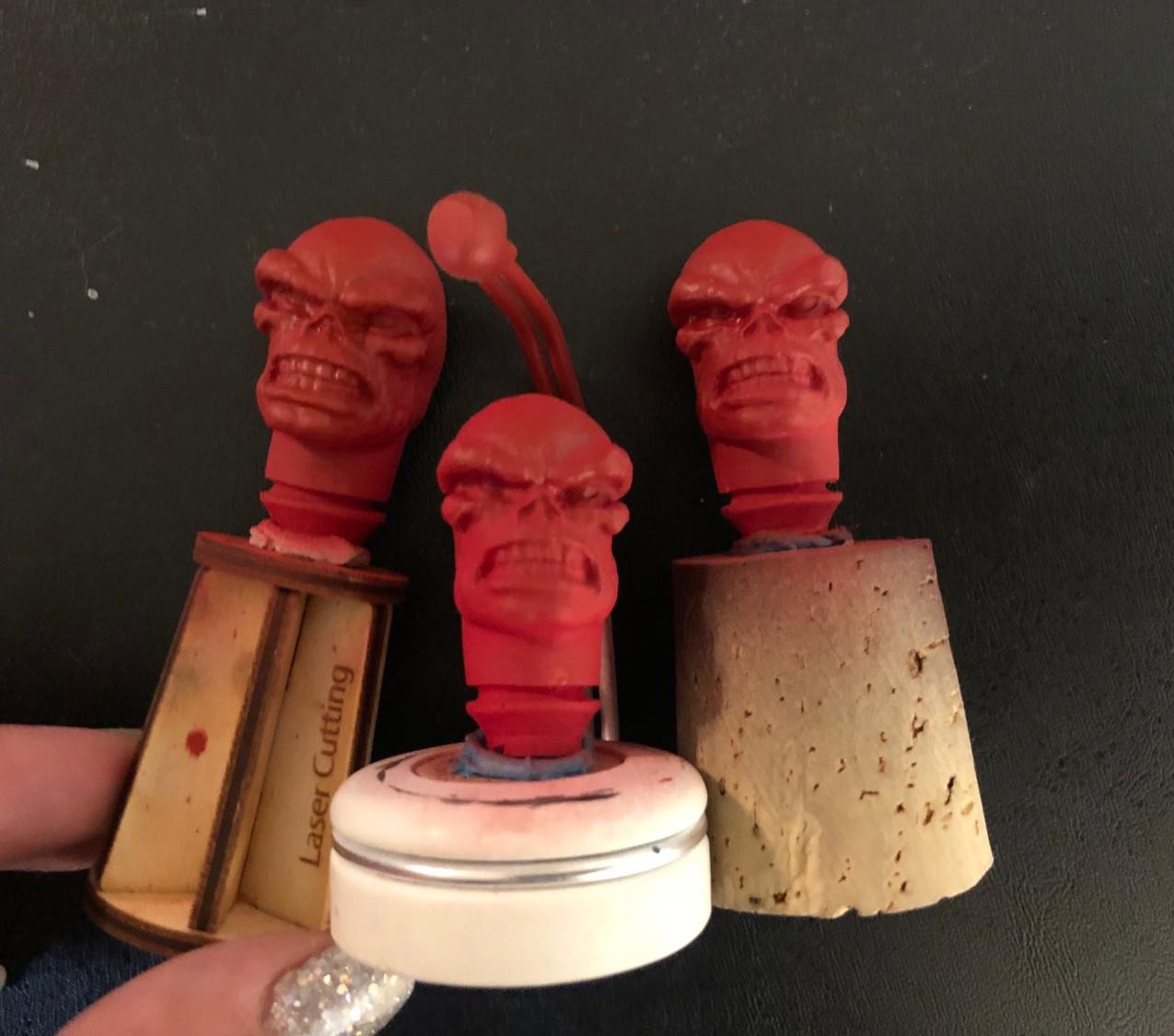 Red base coated Mego heads