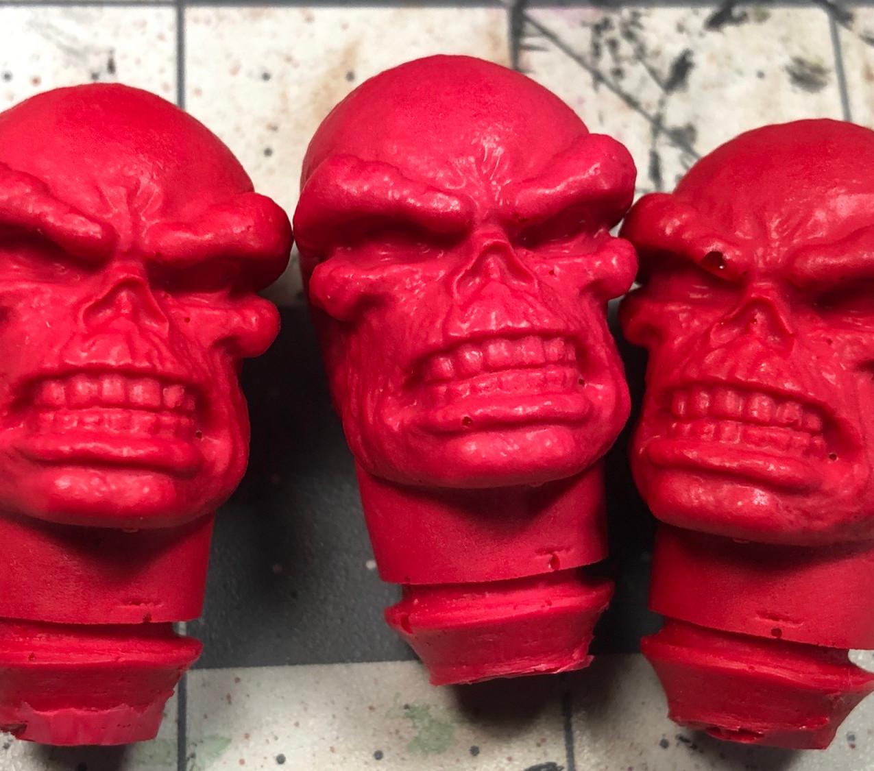 3 cast mego red skull heads