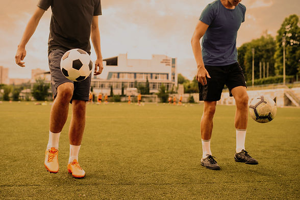 male-soccer-players-stuffs-ball-with-their-feet-field-footballers-outdoor-stadium-team-wor