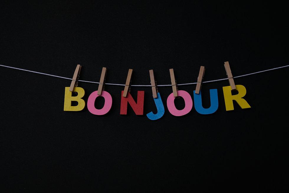 Word Bonjour on black background. Bonjou
