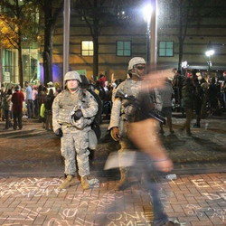 the National Guard in front of the Omni Hotel, where protestor Justin Carr was shot and killed by po