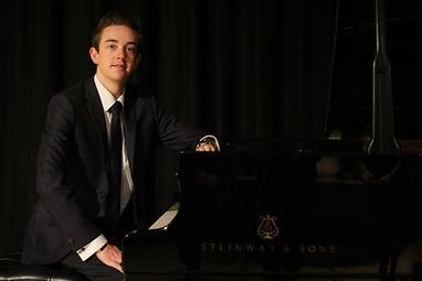 Adam McDonald at piano
