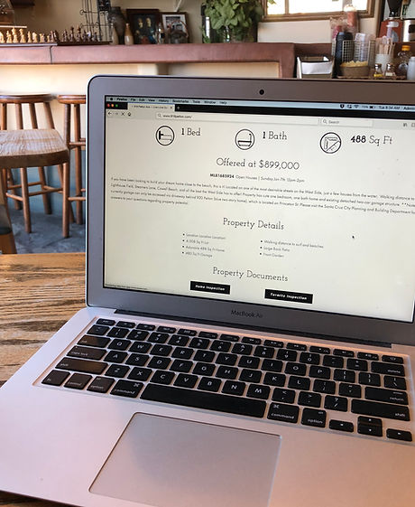 computer in coffee shop custom property website