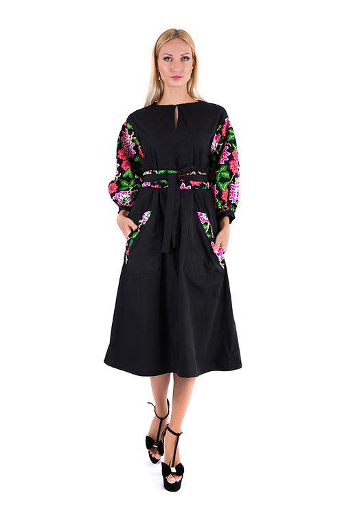 Black dress with crochet flower pattern sleeves