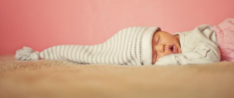 'Sleep train' or gently 'coach' your baby to sleep through the night?