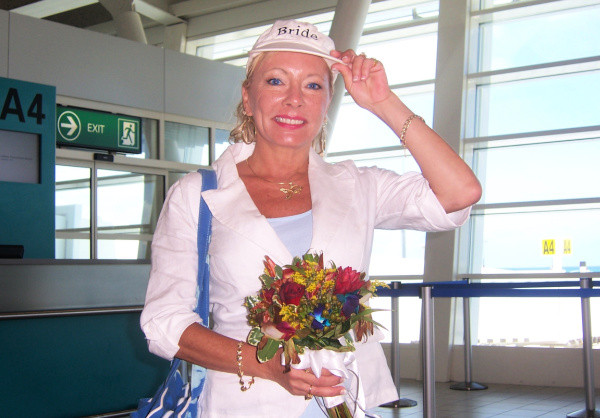 Lisa at airport holding wedding flowers