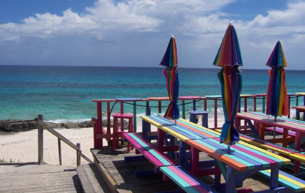 colorfully painted picnic tables with umbrellas at Nippers Bar and Grill