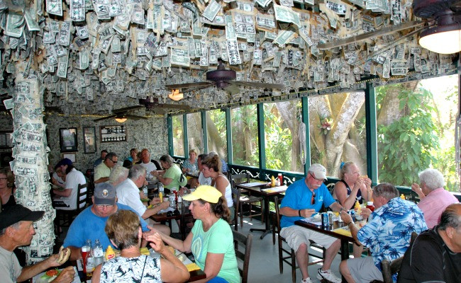 Inside the restaurant at Cabbage Key - walls and ceiling covered in dollar bills