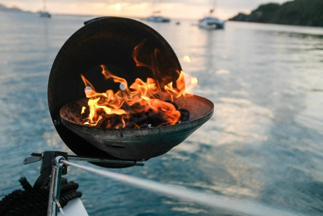 Barbecue grill on the back of a sailboat