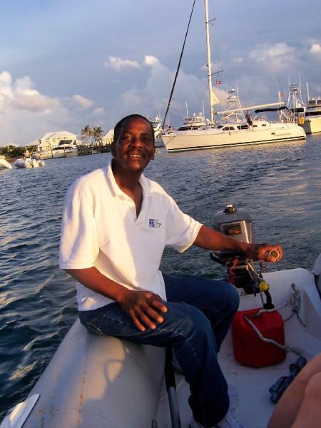 Ali Penn, our captain, operating motorized dinghy