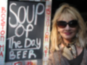Lisa Codianne Fowler outside a restaurant in Boston, where the Soup of the Day is listed as, beer!
