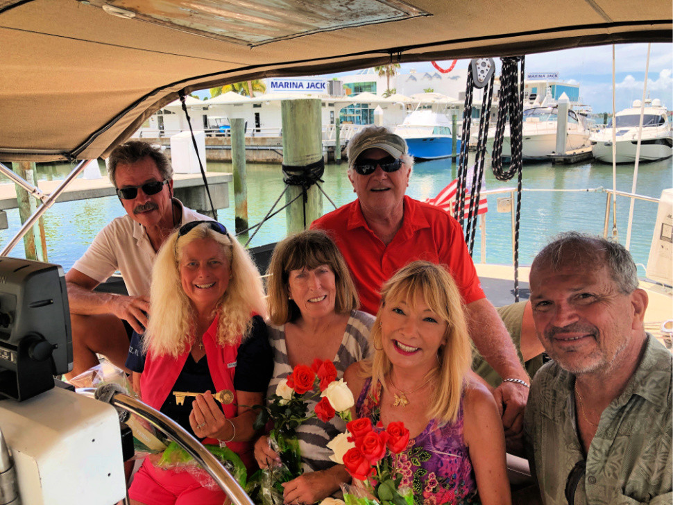 Happy people on sailboat