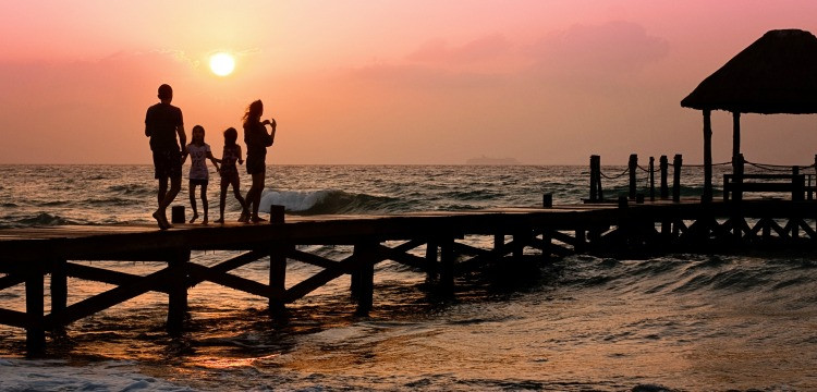 Family on Florida pier at sunset