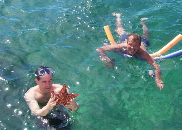 JIm and Patrick snorkeling in clear emerald waters