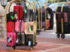 Many suitcases on luggage racks