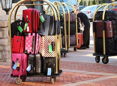 Many suitcases on luggage racks