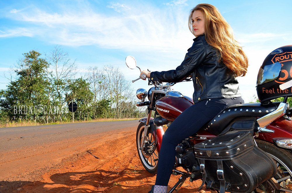Pretty young woman on motorcycle
